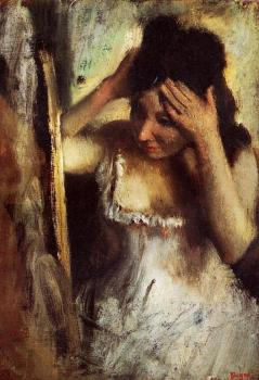 Edgar Degas : Woman Combing Her Hair before a Mirror