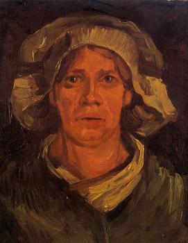 Vincent Van Gogh : Head of a Peasant Woman with White Cap