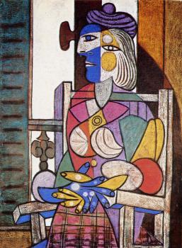 woman seated before the window