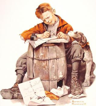 Little boy writing a letter
