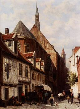 A Busy Street In Bremen With The Saint Johann Church In The Background