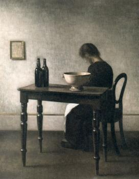 Young woman sitting behind a table