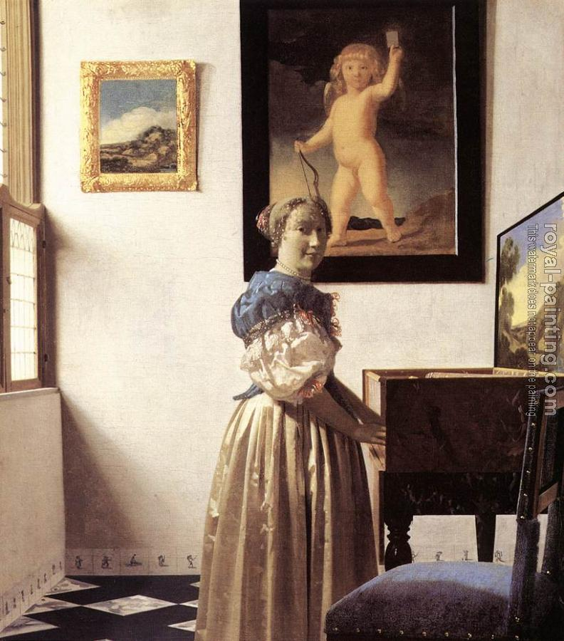 Johannes Vermeer : A Lady Standing at a Virginal